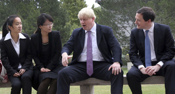Britain's Chancellor of the Exchequer, George Osborne, and Mayor of London Boris Johnson talk to students at campus during a their visit to Peking University in Beijing