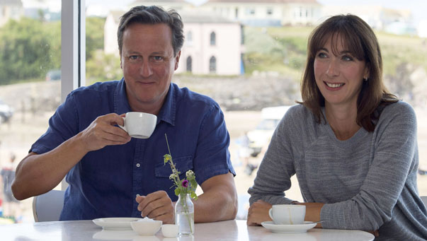 Britain's Prime Minister David Cameron and his wife Samantha pose for a photograph during their holiday in Cornwall, south west England
