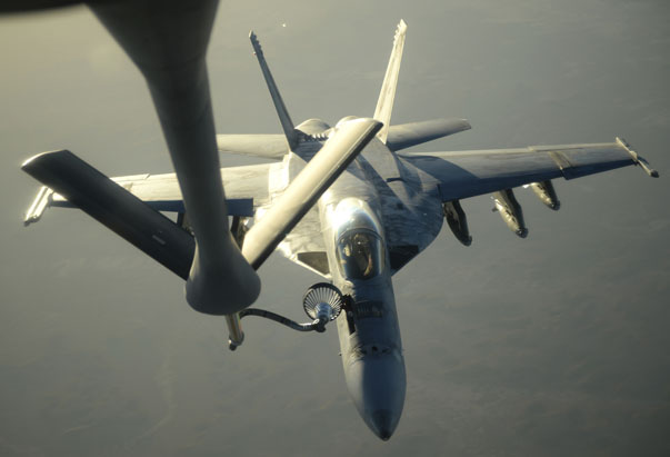 A U.S. Navy F-18E Super Hornet receives fuel from a KC-135 Stratotanker over northern Iraq after conducting air strikes in Syria