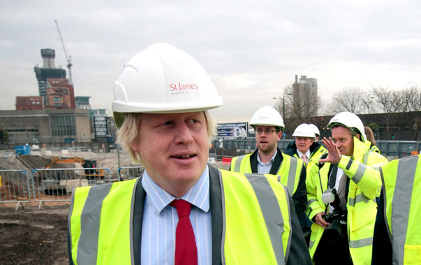 Britain's Chancellor of the Exchequer George Osborne talks to London Mayor Boris Johnson during a visit to the Riverlight construction site in central London