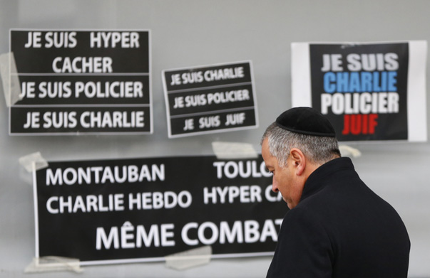 A man pays tribute to the victims of a hostage taking at the Hyper Cacher kosher supermarket near Porte de Vincennes in eastern Paris