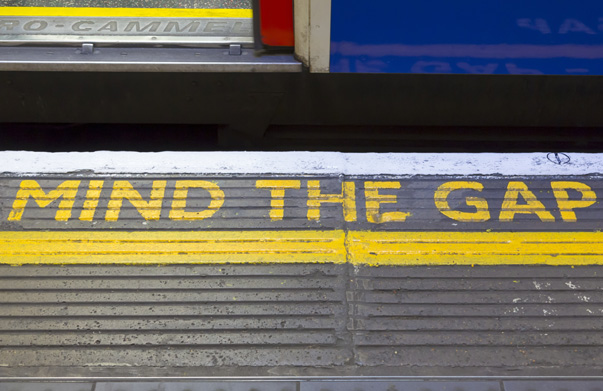 Close up of 'Mind the Gap' sign and train on London