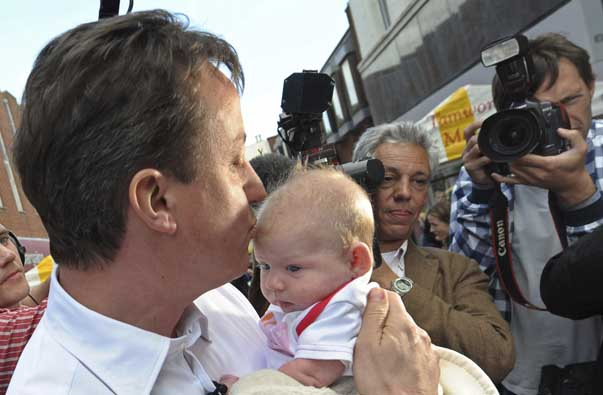 Britain's opposition Conservative Party leader, David Cameron, kisses a baby while campaigning in Tamworth