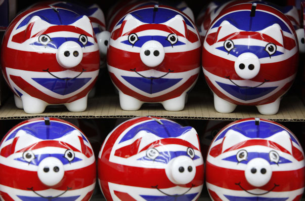 Row of piggy banks adorned with the colours of Britain's Union Jack flag are seen in a souvenir shop in London
