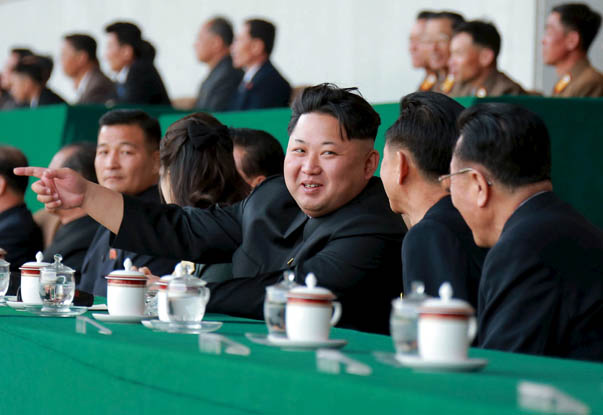 Handout photo of North Korean leader Kim Jong Un watching a men's football match at Kim Il Sung Stadium