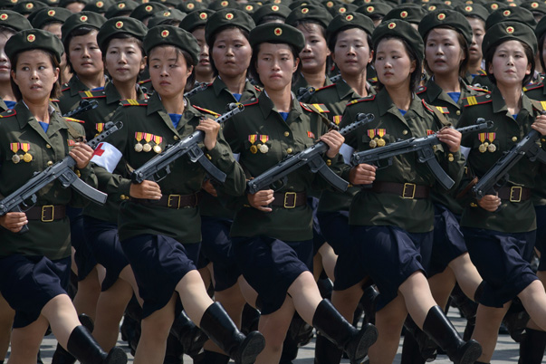 In a photo taken on July 27, 2013 female North Korean soldiers march through Kim Il-Sung square during a military parade marking the 60th anniversary of the Korean war armistice in Pyongyang. North Korea mounted its largest ever military parade on July 27 to mark the 60th anniversary of the armistice that ended fighting in the Korean War, displaying its long-range missiles at a ceremony presided over by leader Kim Jong-Un. AFP PHOTO / Ed Jones (Photo credit should read Ed Jones/AFP/Getty Images)