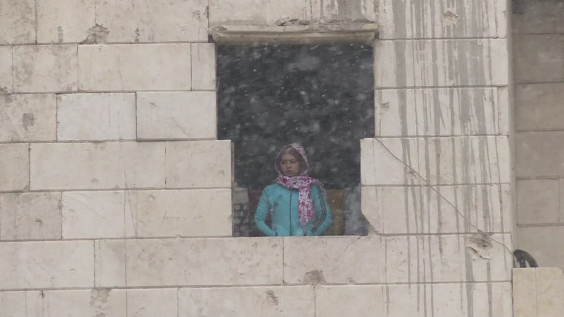 Lady in the snow in Aleppo